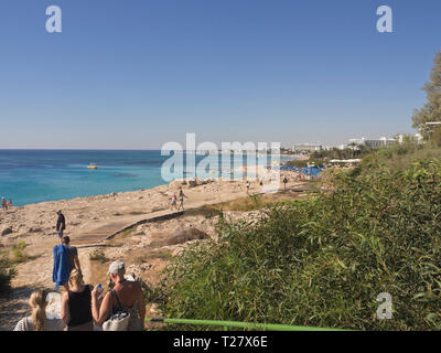 Sun and sea, cliffs and beach, tourists and hotels the essence of a successful holiday in Ayia Napa Cyprus - Stock Image