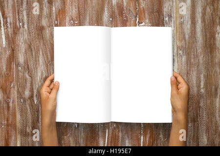 Closeup Blank Open Book White Paper Sheet Holding Male Hands. Mockup Natural Wood Table Background. Empty Mock up - Stock Image