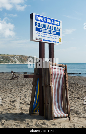 Deck chairs for hire sign on Swanage beach, Dorset - Stock Image