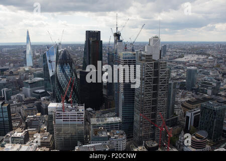 A dramatic low-level aerial view of the City of London - Stock Image