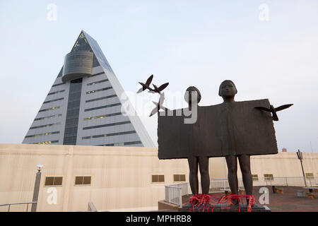 Futari (meaning Two People) statue at Aoiumi Park in Aomori, Japan, with ASPAM building in the background. - Stock Image