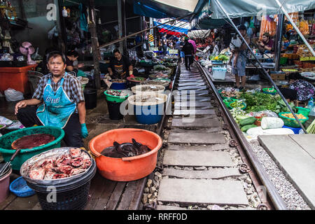 Maeklong, Thailand - August 29, 2018: The famous Railway Market in Maeklong, Thailand. With a train passing right through the market, it is one of the - Stock Image