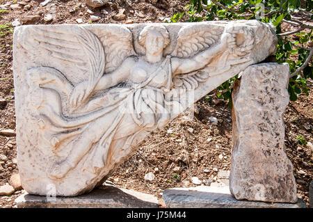Carving of the Goddess Nike at UNESCO World Heritage Archaeological Site, Ephesus, Turkey - Stock Image