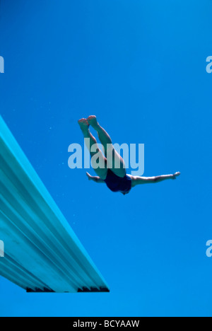 Woman Dives from Board - Stock Image