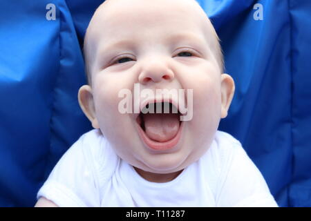 Portrait of a happy baby laughing out loud - Stock Image