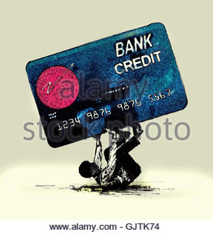 Man struggling beneath large credit card - Stock Image