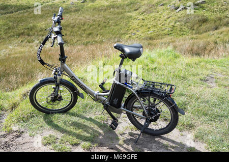 A FreeGo Folder power-assisted bicycle parked in Cumbria UK - Stock Image