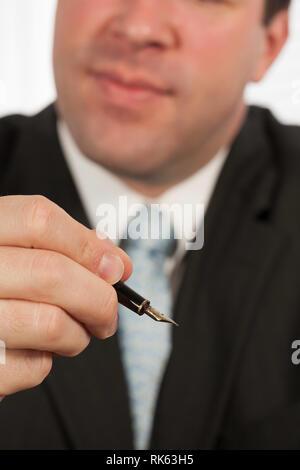 Businessman Holding a Fountain Pen, USA - Stock Image