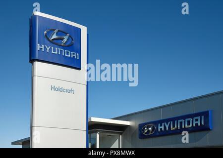 A Hyundai pylon sign outside a car dealership - Stock Image