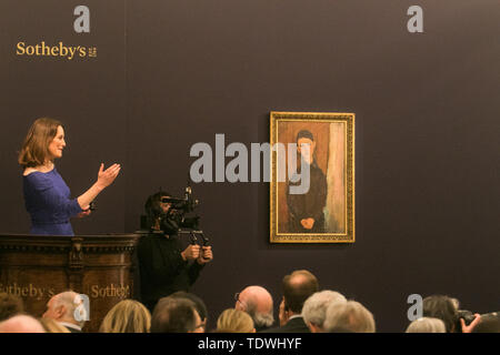 London UK. 19th June 2019.  'Jeune Homme assis les mains croisées sur les genoux' by Amadeo Modigliani,  oil on canvas, Estimate at £16,000,000m sold at hammer for £16,000,000m at the Impressionist & Modern Art Evening Auction  at Sotheby's London Credit: amer ghazzal/Alamy Live News - Stock Image