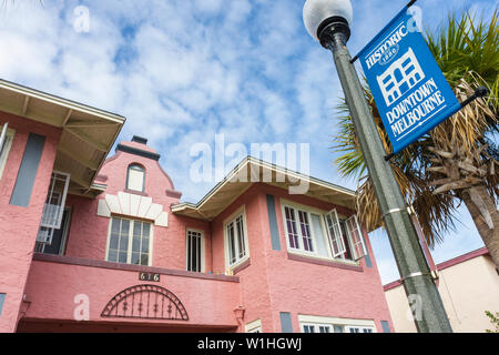 Melbourne Florida Historic Downtown Main Street revitalization preservation house building pink street lamp banner - Stock Image