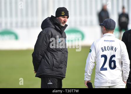 Hove Sussex, UK. 05th Apr, 2019. Jason Gillespie the Sussex coach before the Specasavers County Championship Division Two match between Sussex and Leicestershire at the 1st Central County Ground in Hove on a sunny but cool first morning of the season Credit: Simon Dack/Alamy Live News - Stock Image