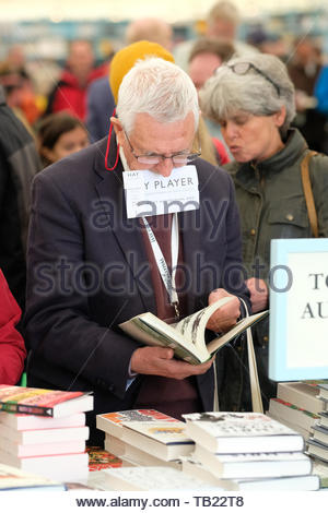 Hay Festival, Hay on Wye, Powys, Wales, UK - Wednesday 29th May 2019 - A man hangs onto his ticket for his next event whilst browsing the books in the Festival bookshop. at the Hay Festival. The eleven day Festival features over 800 events - the Hay Festival continues to Sunday 2nd June. Credit: Steven May/Alamy Live News - Stock Image