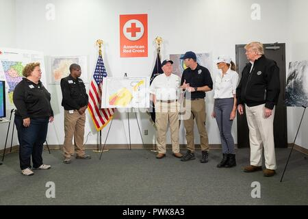 Panama City, Florida, USA. 15th Oct 2018. U.S President Donald Trump, First Lady Melania Trump, FEMA Administrator Brock Long and Agriculture Secretary Sonny Perdue during a briefing on relief efforts in the aftermath of Hurricane Michael at the Georgia Operations Center October 15, 2018 in Warner Robins, Georgia. Credit: Planetpix/Alamy Live News - Stock Image