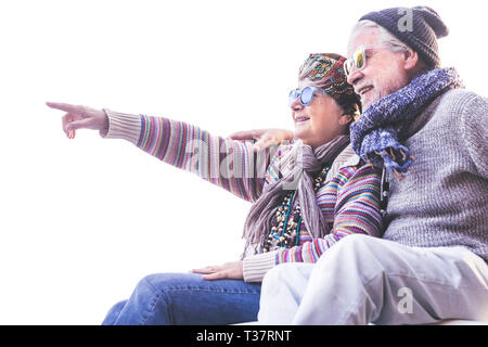 Happy cheerful people old senior caucasian couple smile and hug toegether with love and nice retired lifestyle outdoor leisure activity - white clear  - Stock Image