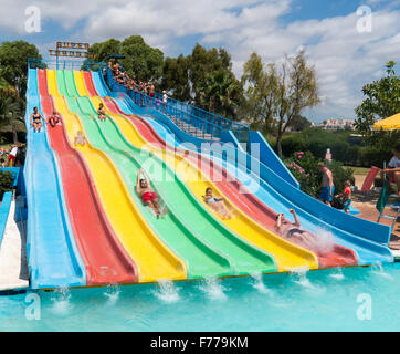 People on a waterslide in Aquamar Water Park, Platja dÕen Bossa, Ibiza Spain - Stock Image