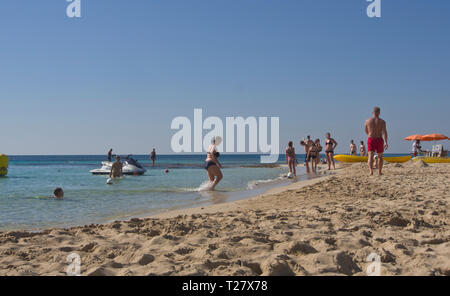 A low angle view of a lazy day on the Grecian - Glyki Nero Beach in Ayia Napa Cyprus - Stock Image