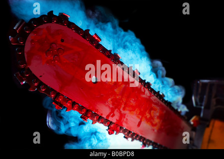 Bloody chainsaw movie cliche - Stock Image