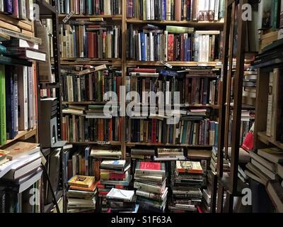 Books stacked up in bookstore - Stock Image