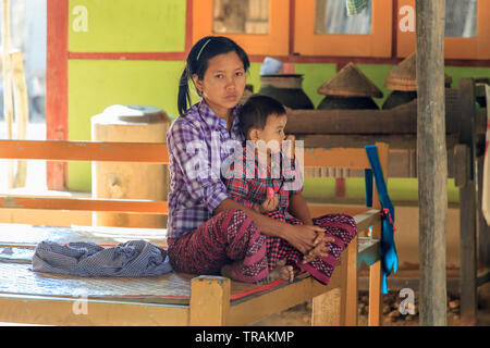 Life in the village: young mother with her son - Stock Image