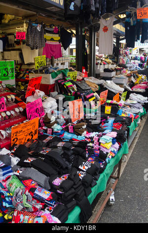 Stall on Bury market selling socks, men's briefs and miscellaneous clothing. - Stock Image