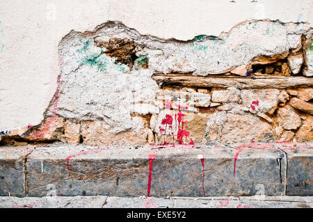 Part of a an external wall which has been damaged - Stock Image