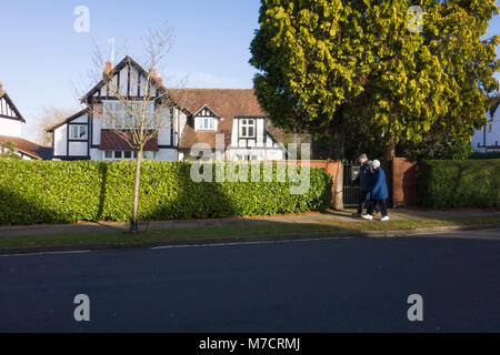 Typical detached English Neo-Tudor suburban house behind hedges in Bristol, UK. - Stock Image