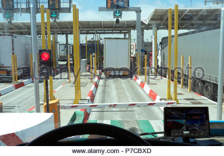 Eurotunnel Calais Terminal - truck check-in booths at the entrance to the cross channel crossing complex, at Coquelles, France. - Stock Image