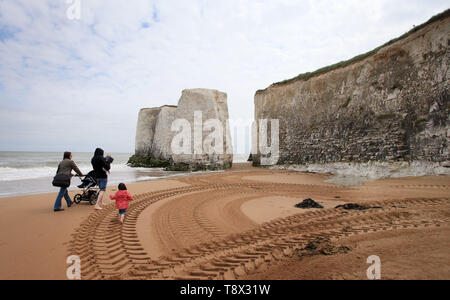 A family walk along Botany Bay beach in Margate, Kent, one of 71 beaches that have been awarded a Blue Flag award by Keep Britain Tidy. - Stock Image