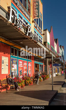 Sept. 17, 2018 - Ketchikan, AK: Shops, pedestrains and wooden boardwalk, Spruce Mill Way, near closing time in late afternoon sunlight. - Stock Image