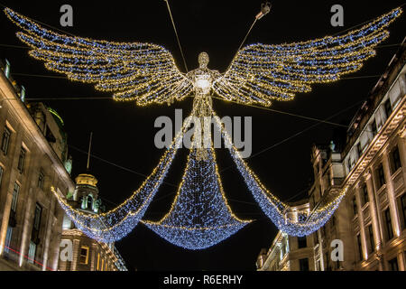A close-up view of the Christmas Lights on Regent Street in London, UK. - Stock Image