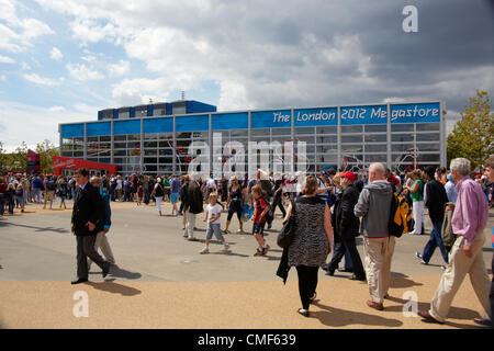 People queueing outside Megastore on a sunny day at Olympic Park, London 2012 Olympic Games site, Stratford London - Stock Image
