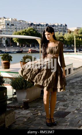 Fashion model posing outdoors. Fashion photography - Stock Image