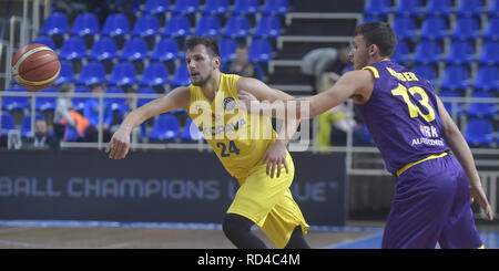 Opava, Czech Republic. 16th Jan, 2019. Jakub Sirina of Opava, left, and Roi Huber of Hapoel fight for a ball during the Group B, 11th round of the Champions League match BK Opava vs Hapoel Holon in Opava, Czech Republic, January 16, 2019. Credit: Jaroslav Ozana/CTK Photo/Alamy Live News - Stock Image
