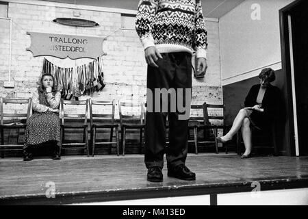 Competitor on stage at Trallong small eisteddfod in Sennybridge Market Hall Powys Wales UK - Stock Image