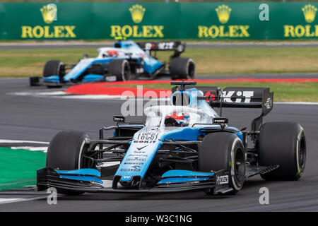 Silverstone, UK. 14th July 2019. FIA F1 Grand Prix of Britain, Race Day; ROKiT Williams Racing team mates, George Russell and Robert Kubica Credit: Action Plus Sports Images/Alamy Live News - Stock Image