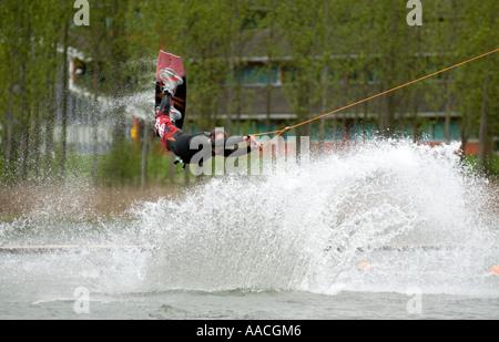 wakeboard wakeboarding extreme xtreme action sport spray Willen Lake water Milton Keynes MK - Stock Image