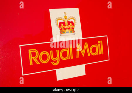 The Royal Mail logo on the back of a Royal Mail van. - Stock Image