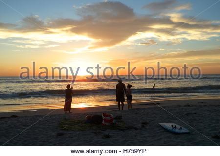 The sun sets across the Pacific Ocean, at Solana Beach (San Diego County), California, USA. - Stock Image