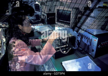 a women works in a Chip Produktions company in the city of  Kuala Lumpur in Malaysia in southeastasia. - Stock Image