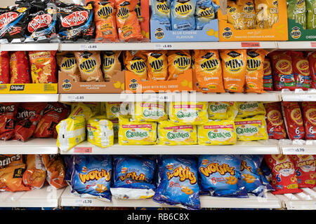Bags of crisps on sale at a Sainsburys supermarket - Stock Image
