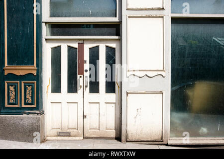 Old shop doorway of a closed down business, Nottingham, England, UK - Stock Image