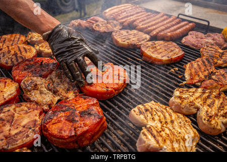 Selection of meat grilling over the coals - Stock Image