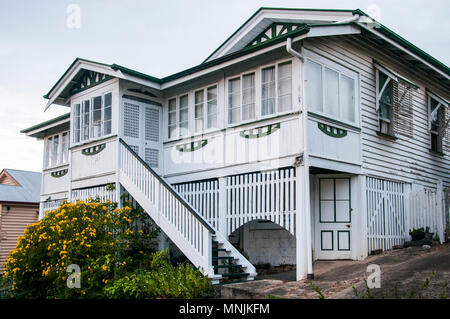 Queenslander-style timber home ca. 1913, typically featuring Art Nouveau decorative motifs, Brisbane, Australia - Stock Image