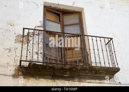 A rusty balcony. Baeza, Jaén province, Andalusia, Spain. - Stock Image