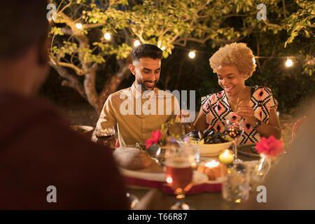 Couple enjoying dinner garden party - Stock Image