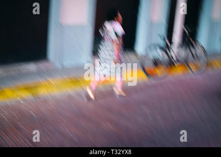 Guna Yala Woman with Traditional Clothes Walking in Panama City - Stock Image