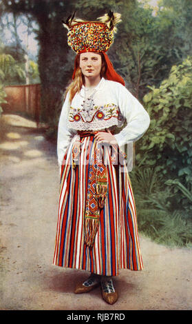 Young woman from Oesel Island (Saaremaa, Osel), Republic of Estonia, dressed in her bridal costume, including an elaborate headdress. - Stock Image