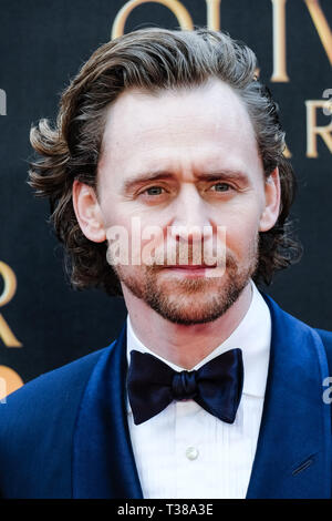 London, UK. 7th Apr 2019. Tom Hiddleston poses on the red carpet at the Olivier Awards on Sunday 7 April 2019 at Royal Albert Hall, London. Picture by Credit: Julie Edwards/Alamy Live News - Stock Image