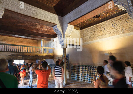 Tourists in the Mexuar room at The Alhambra Palace in Granada Spain - Stock Image